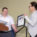 Nancy Patota presents Yaniv Gorodischer with The Anthony Cannata Memorial Employee Award