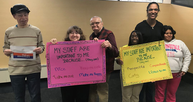 People holding self advocacy banners
